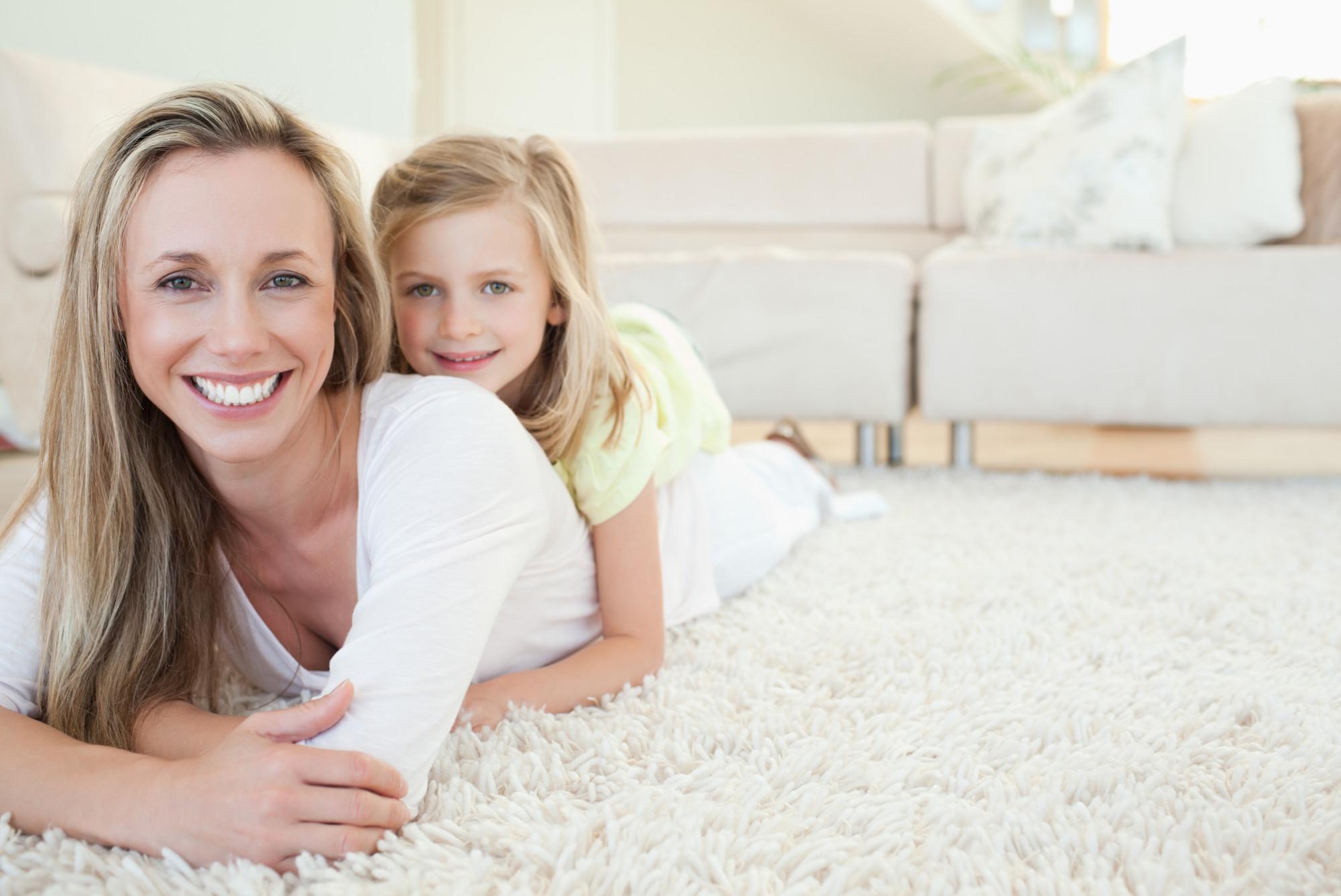 happy family faces on clean carpet Slidell LA